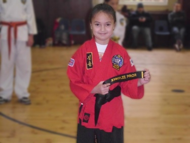 Photo of a black belt child in class