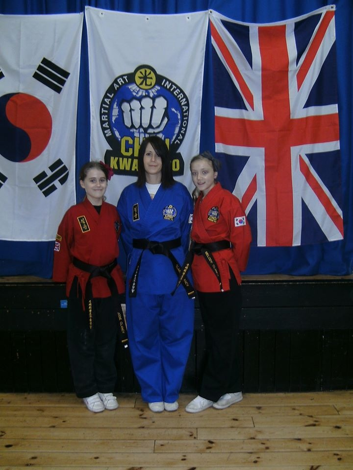 Black belts and Choi Kwang-Do flags